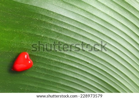 Thai dessert call Kanom Look choup or deletable imitation fruits is a kind of Thai traditional style dessert Thai traditional cuisine ready to serve on green color banana leaf.  - stock photo