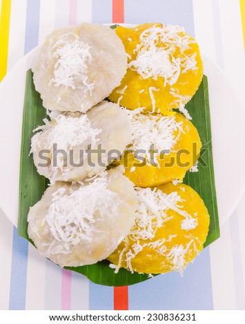 """Thai dessert call """"Kanom thuay"""" in white and yellow color (Coconut milk custard in small porcelain cup)  - stock photo"""