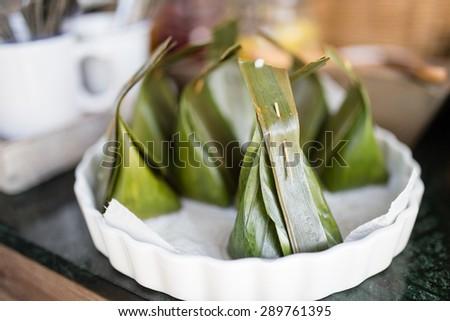 Thai dessert, Thai style banana leaf packaging - stock photo