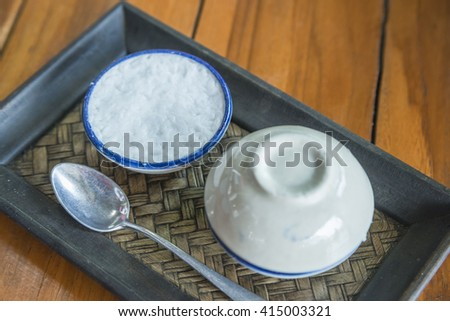 Thai desserts favorite Thailand delicious popular of process of making coconut milk custard in small porcelain cup. - stock photo