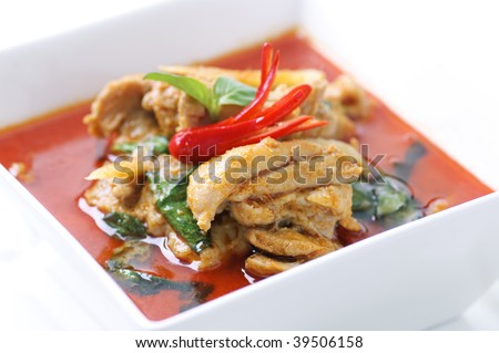 Thai dish, chicken in red curry. - stock photo
