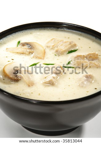 Thai Dishes - Soup made from Coco Milk and Mushrooms and Chicken Meat - stock photo