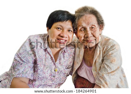 Thai elder mother and daughter hugging in isolated background - stock photo