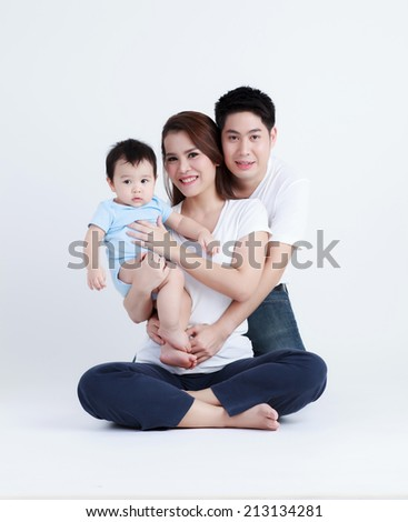 Thai family smiling with happily isolated - stock photo