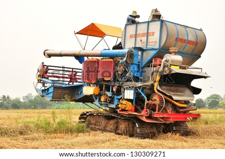 Thai farmers are using. Harvest is harvested at rice field in Angthong,Thailand - stock photo