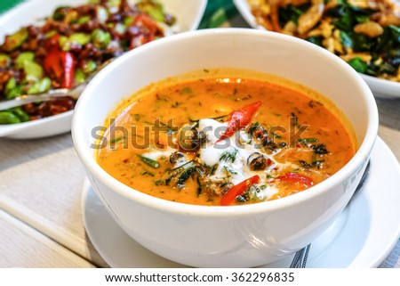 Thai fine restaurant share dishes food - Shell red curry - stock photo