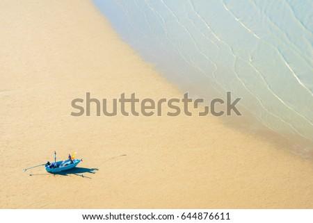 stock-photo-thai-fishermen-boat-waits-fo