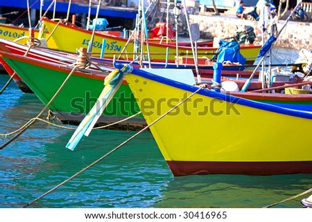 Thai fishing boats anchored at the pier