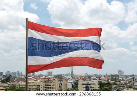 thai flag with blue sky and clouds.