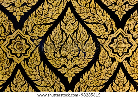 Thai Floral pattern painting on door of Buddhist temple - stock photo