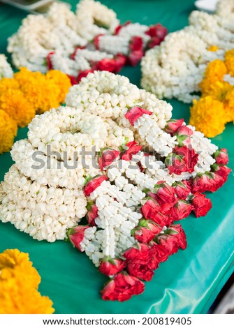 Thai flower garland mix by Jasmines, Roses and Marigold. - stock photo