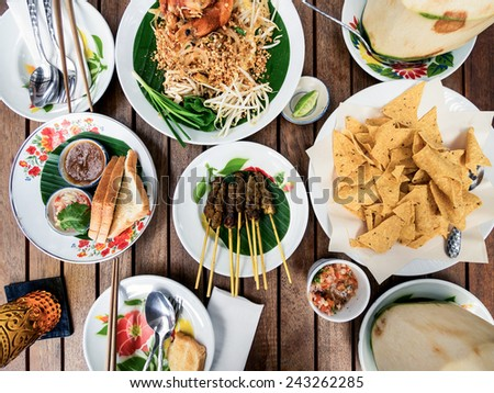 Thai food and side dishes with fresh coconut drink. - stock photo