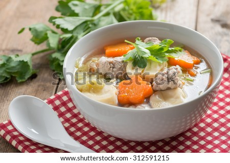 Thai food, Clear Soup with Vegetables and Meatballs in white bowl. - stock photo