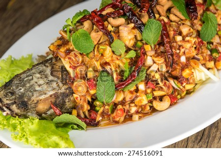 Thai Food,Fried fish with spicy toppings. - stock photo