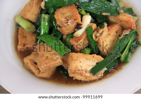 Thai food. fried tofu stir with garlic leafs, pepper, and sauce - stock photo