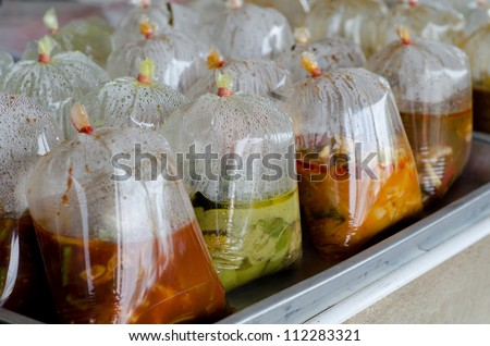 Thai food in plastic bag, thai street food. - stock photo