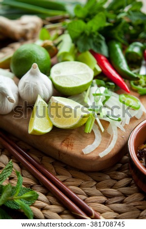 thai food ingrediants herb board garlic lime chili mint spring onion ginger - stock photo