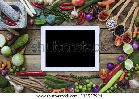 Thai food ingredients and tablet, vegetable, spicy taste  - stock photo