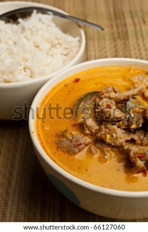 thai food is name pork curry coconut milk with rice - stock photo