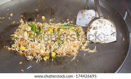 Thai food Pad thai , Stir fry noodles with shrimp in market. - stock photo