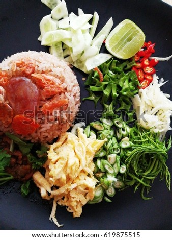 Thai food ,Rice mixed with shrimp paste, sausage and vegetables