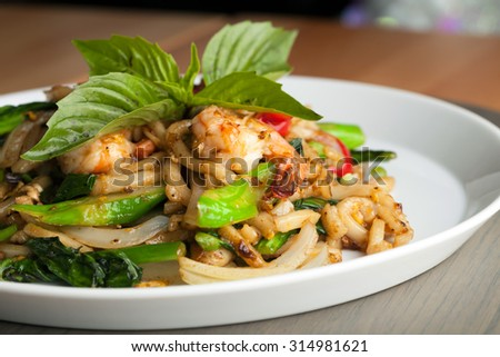Thai food shrimp stir fry with lo mein noodles Shallow depth of field. - stock photo