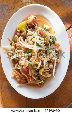 Thai Food (somtum) spicy papaya salad with dried shrimp. - stock photo