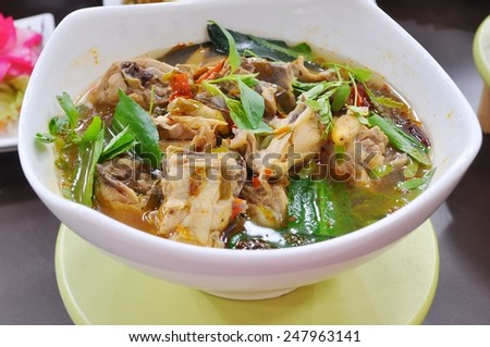 Thai food - Spicy chicken soup with herbs - stock photo