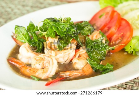 Thai food, Spicy fried shrimp with basil - stock photo