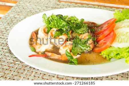 Thai food, Spicy fried shrimp with basil leaves - stock photo