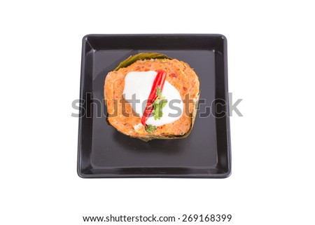 thai food, steamed fish curry custard in banana leaf on white background - stock photo