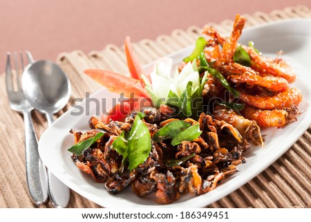 Thai food, Thai food shrimp in orange sweet and spicy herb sauce  - stock photo