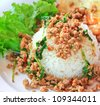 Thai food Thai spicy food, Fried pork with sweet basil.whit basi - stock photo