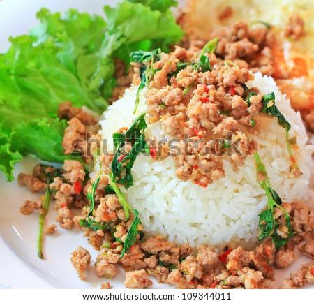 Thai food Thai spicy food, Fried pork with sweet basil.whit basi - stock photo