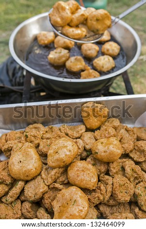 Thai Food (Tod Mun) fried fish mix herbs served with sweet chili sauce - stock photo