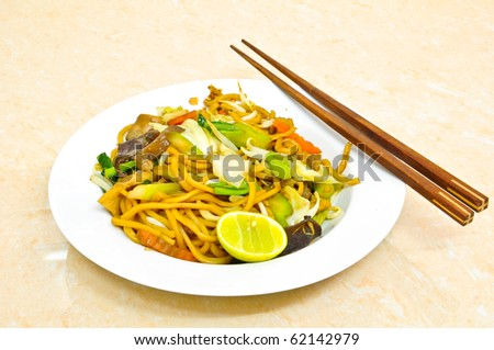 Thai Food - Vegetarian Fried Noodles with Chopsticks - stock photo