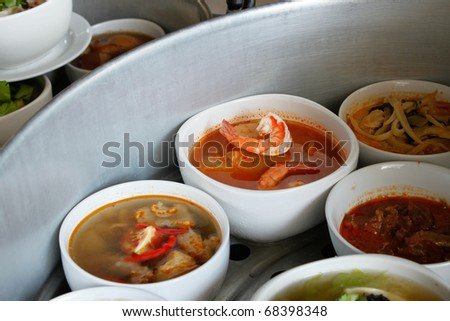 Thai foods - focus on shrimp in Kaeng Som(Hot-and-sour-curry) - stock photo