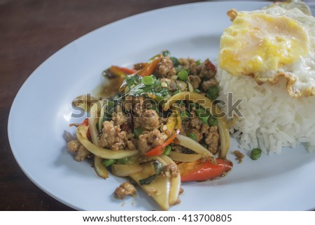 Thai fried meat with basil leaf chili and fried egg