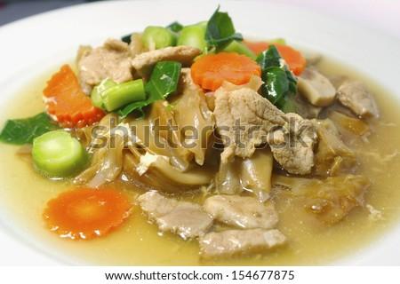Thai Fried Noodles, fried noodles with pork sliced and vegateble - stock photo
