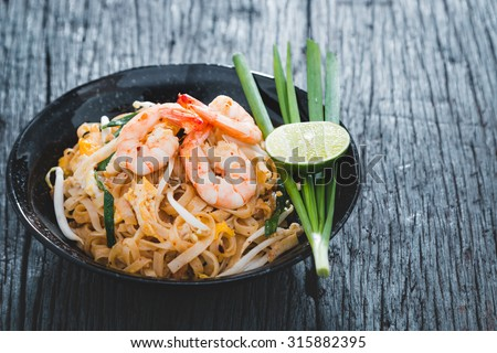 """Thai Fried Noodles """"Pad Thai"""" with shrimp and vegetables - stock photo"""