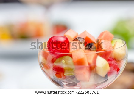 thai fruit salad in cocktail glass on food table - stock photo