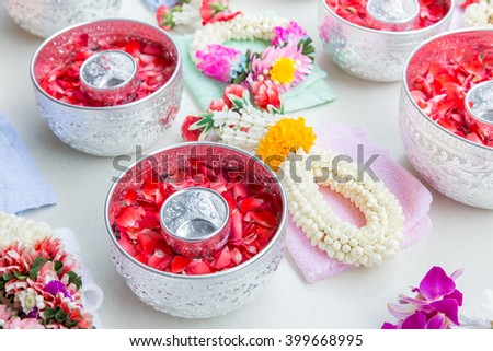Thai garland Flowers and roses corolla in silver bowl (Use for S - stock photo