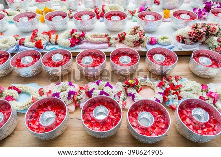 Thai garland flowers and roses corolla in silver bowl (Use for Songkran festival in Thailand) - stock photo
