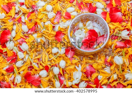 Thai garland Flowers with petal of jasmine, marigold and roses  in water dipper or bowl and small bowl in this  Use for respect to parent and the old man  in Songkran festival in Thailand - stock photo