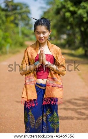 thai girl in traditional isaan style clothes with typical welcome expression - stock photo