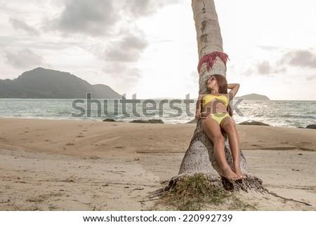 Thai girl on the beach - stock photo