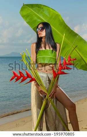Thai girl on the beach in Phuket - stock photo