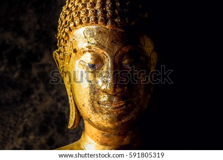 Thai Golden Buddha Face Statue Close Up For Light Side And Dark