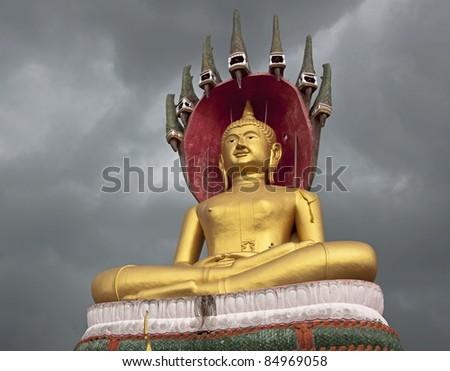Thai Golden Buddha Statue in Thailand , before the rain will fall - stock photo