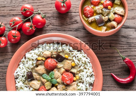 Thai green chicken curry with mix of white and wild rice - stock photo